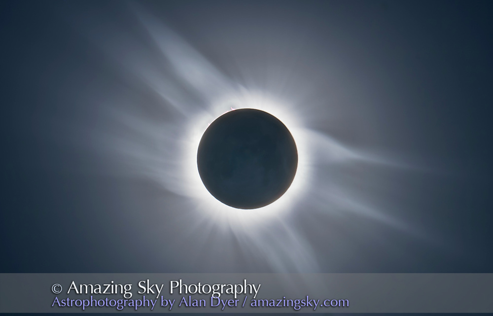 A composite of the total solar eclipse of March 29, 2006 from Libya.<br /> <br /> The composite of totality shows the full extent of the solar corona, the Sun&rsquo;s outer atmosphere. This image is a stack of 7 exposures, from 1/800th second to 0.8 seconds, and blended with luminosity masks to bring out the faintest extent of the outer corona while still preserving detail in the bright inner corona. A high pass filter brought out the structure in the corona.<br /> <br /> The corona is shaped by brushes emanating away from the solar poles at top right and lower left of the disk, and long tapering plumes from the middle and equatorial latitudes of the Sun.<br /> <br /> Note the faint image of the Moon&rsquo;s disk itself is visible here, from the longest exposure. The New Moon&rsquo;s disk is lit by light from the fully illuminated Earth in the lunar sky. While long exposure photos bring out the earthlit lunar disk, to the eye the Moon looks utterly black during totality. <br /> <br /> I shot all images with a Canon 20Da camera shooting through a 66mm aperture WIlliam Optics f/6 apo refractor on a alt-az tripod with no tracking. Images were manually aligned in Photoshop. The location was the desert of Libya south of Tubruq. I was with a TravelQuest/Sky and Telescope eclipse tour.