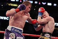 March 5, 2011; Anaheim, CA; USA; Saul Alvarez and Matthew Hatton during their bout on HBO's Boxing After Dark at the Honda Center in Anaheim, CA.