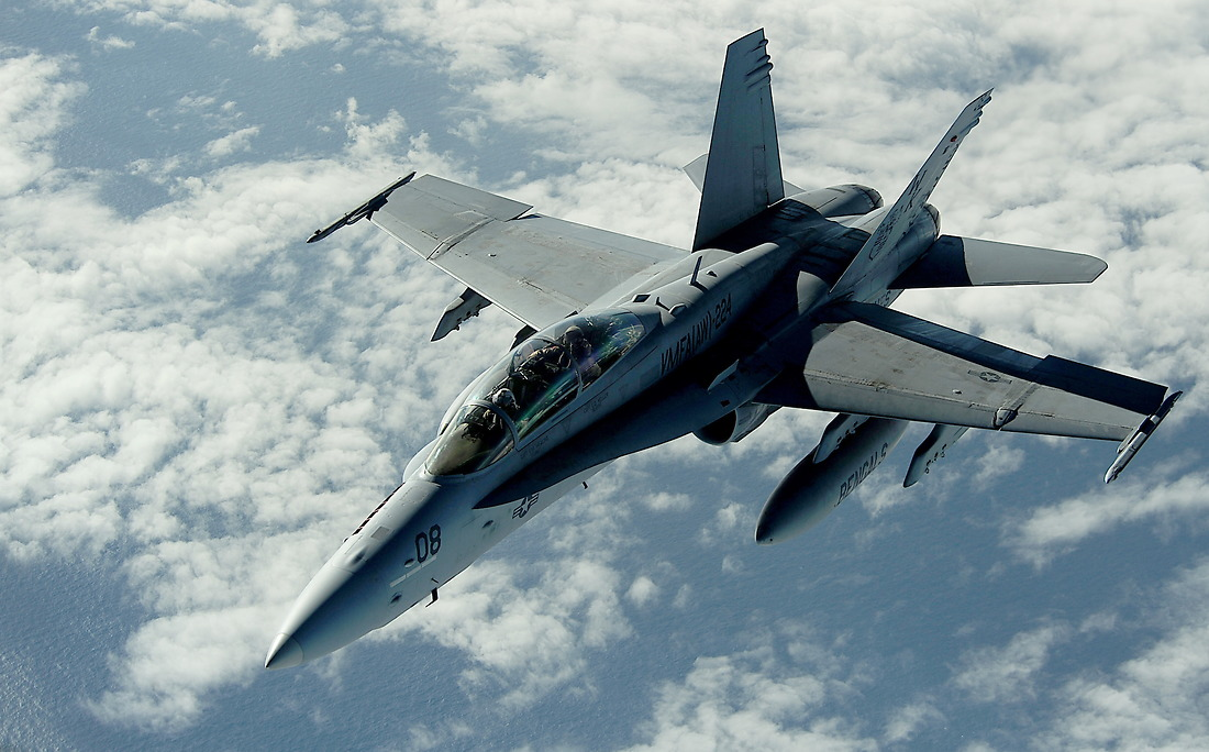 A U.S. Marine F/A-18 Hornet from the All Weather Fighter Attack Squadron 224 (VFMA (AW)-224), Marine Corps Air Station Beaufort, South Carolina, flies next to a KC-135 Stratotanker with the 465th Air Refueling Squadron, Tinker AFB, Oklahoma, after receiving fuel during a refueling mission on July 9, 2010, in support of RIMPAC 2010 at Hickam AFB, Hawaii. — © MSgt Jeremy Lock/