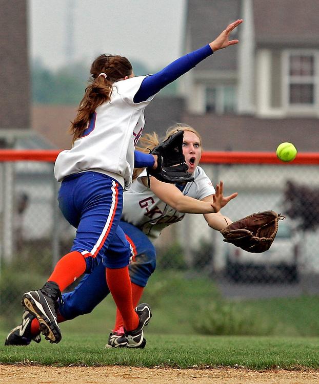 SCOTT MORGAN | ROCKFORD REGISTER STAR.Genoa-Kingston High School's Liz Brown (9) dives to catch Forreston fly ball in the fifth-inning Saturday, May 21, 2011, in the IHSA Class 2A Regional at Genoa-Kingston.