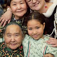 Four Generations of CUP'IK doll makers: Rusalie Paniyak (Lower left); Ursula Paniyak-Irvin (Upper left); Janice Tamang (Upper right) and Jaderiane Paniyak (Lower right), at the Alaska Federation of Natives craft fair, Anchorage