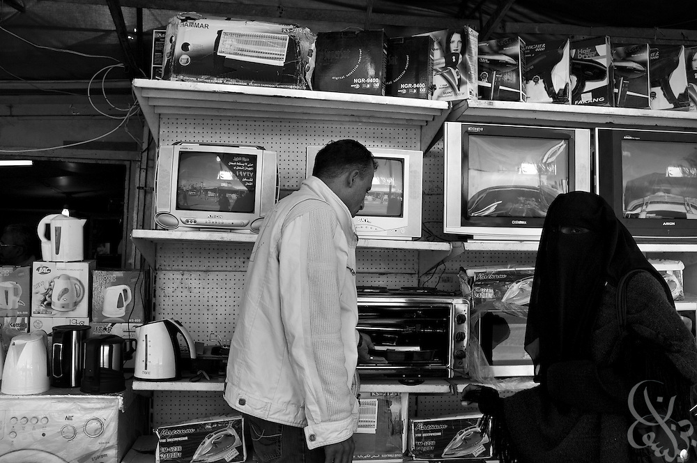 With more than a thousand smuggling tunnels running under the Gaza-Egypt border, the supply of even consumer goods is diverse and plentiful in the markets of Gaza, as seen here in a December 20, 2009 image of a Palestinian couple shopping for home appliances from Rafah, Gaza. Despite the 22 day Israeli offensive last year in Gaza, tunnels have proliferated to the point where the vast supply of goods has exceeded demand, causing prices to dramatically fall and tunnel profits to plummet.