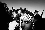 &quot;NOTE&quot; small digital files !<br /> On Nov. 11 2004, Yassir Arafat died at a french military hospital. The day after, world leaders honored him at a ceromony in Cairo and afterwards his casket was brought by helicopter to his compound in Ramallah &ndash; The compound in which Israel confined him for years. Amid houndreds of thousands of  chaotic and highly emotional mourners Yasser Arafat was buried. He died at the age of 75. <br /> Mourners wait for the helicopter to arrive from Cairo.