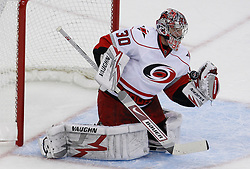 Apr 23, 2009; Newark, NJ, USA; Carolina Hurricanes goalie Cam Ward (30) makes a glove save during the first period of game five of the eastern conference quarterfinals of the 2009 Stanley Cup playoffs at the Prudential Center.