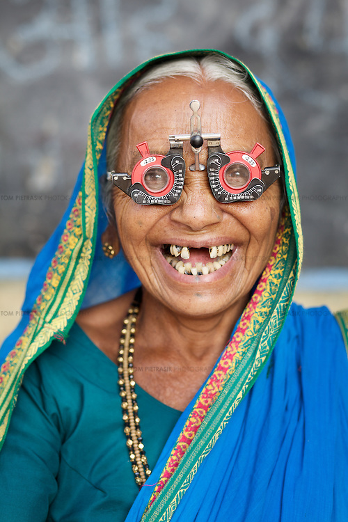 Sakarba Mankrao Gore from the Mumbai slum of Dharavi attends an eye clinic run by the Mumbai Eye Care Campaign. The clinic provides a consultation for a nominal fee for a poor community that would otherwise be unlikely to seek the service. The aim of the campaign is to identify eye conditions and provide treatment in weekly clinics held in 15 locations around the city. ..Photo: Tom Pietrasik.Mumbai, India.January 22nd 2010