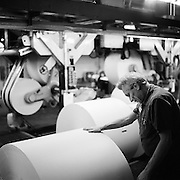 """I'm only a year or two short of retirement, so I'll be fine. I've been a blue collar guy my whole life. My body's all used up, but I'll find a way."" Rick Schrecengost, 62, a 28-year veteran of the Statesman Journal press, pushes rolls of newsprint paper that weigh as much as a car. The old press of the Statesman Journal is about to go dark. Newspapers will no longer be printed on-site in Salem."