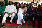 """ThisDay newspaper's Editor-in-chief Nduka Obaigbena (l), the organizer of the annual ThisDay Festival sits with celebrity guests super model Naomi Campbell (c) and fashion designer Ozwald Boateng (r) as they participate in a tree planting ceremony July 11, 2008 in Abuja, Nigeria. The 3rd Annual ThisDay Festival, themed """"Africa Rising"""", is an effort to promote positive images of Africa by celebrating its' music, fashion and culture."""