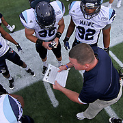 University of Maine Special Teams Coordinator Kyle Archer reviews the game plan prior to a Week 6 NCAA football game against Delaware.