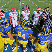 Delaware and Delaware State players convene at centerfield for the coin toss prior to a Week 2 NCAA football game between Delaware and Delaware State University. <br /> <br /> Delaware defeated Defeated Delaware State 42-21 Saturday. Sept Sept. 07, 2013 in Newark Delaware.