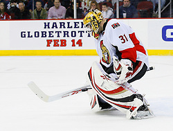 Jan 4, 2008; Newark, NJ, USA; Ottawa Senators goalie Alex Auld (31) makes a stick save during the second period at the Prudential Center.