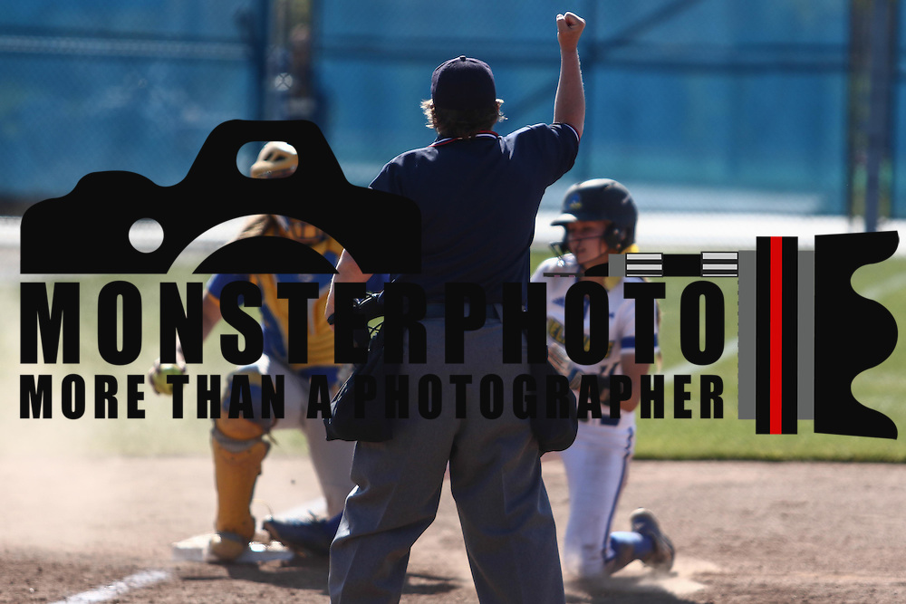 Home Plate Umpires Diane Carden calls the runner out at third base during a Colonial Athletic Association regular season softball game between Delaware and Hofstra Saturday, April 16, 2016, at Delaware softball stadium in Newark, Delaware.