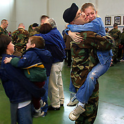 February 15, 2003 - Troops from 1st Batallion, 162nd Infantry mass at the Gresham Armory  to gear up and say goodbye to their families. Later they are bused to PDX and loaded onto a flight for Ft. Carson in Colorado Springs, CO. for several weeks of training. SPC Anthony Acuna comforts his daughter Haley, 11, as he says goodbye to his family. He is a troop medic.