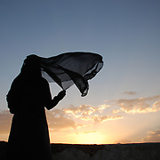 """New Day'"" by Amira Al-Sharif Yemeni Woman looks at sunset."