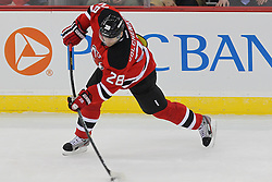 Jan 22, 2013; Newark, NJ, USA; New Jersey Devils defenseman Anton Volchenkov (28) takes a shot during the first period at the Prudential Center.