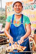 Roadside stall selling Isaan food: som tam (papaya salad) and gai yang (grilled chicken), Udon Thani