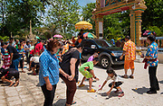 Children scramble to collect good luck ribbons thrown by monks at a #Songkran 2017 celebration in Nakhon Nayok, Thailand. PHOTO BY LEE CRAKER