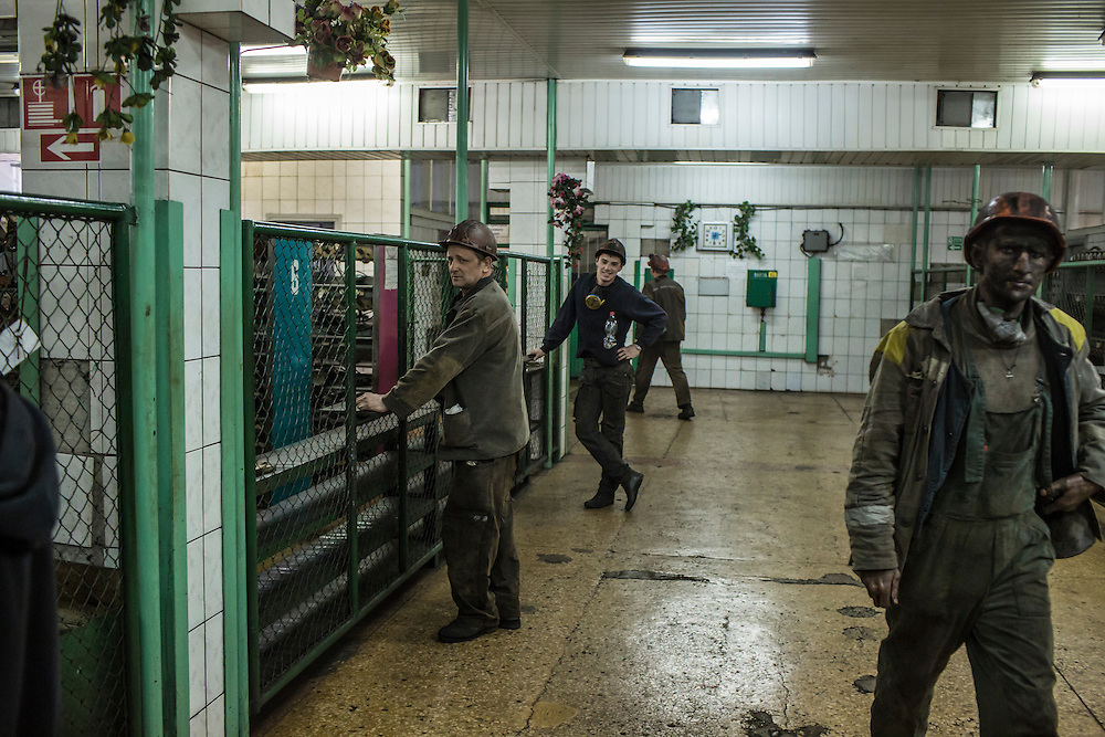 Miners in the equipment room, where they pick up a light and emergency breathing apparatus before going underground, at the Shcheglovskaya Coal Mine on Friday, March 25, 2016 in Makiivka, Ukraine.