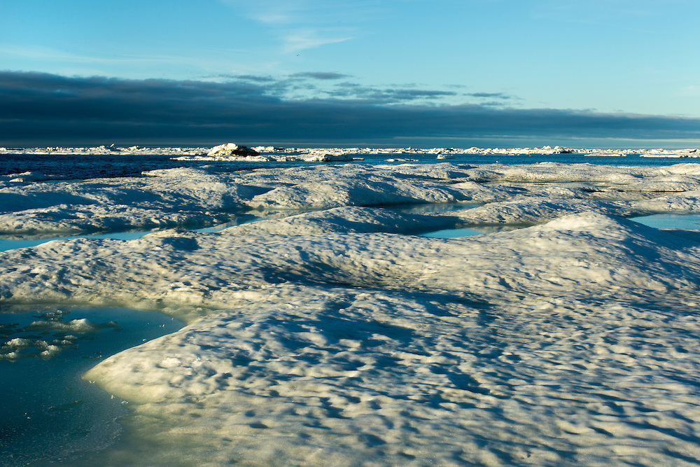Canada, Manitoba, Churchill, Massive pan of melting sea ice on Hudson Bay on sunny summer evening