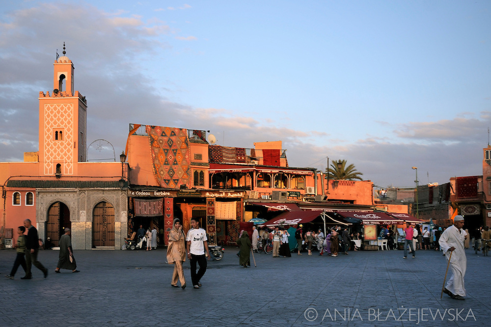 Morocco, Marrakesh. People at Djemaa el-Fna Square during the sunset.