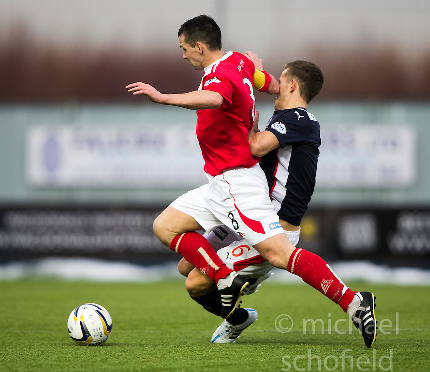 Falkirk's Will Vaulks gets hurt in the challenge from Brechin City&rsquo;s Craig Molloy. <br /> Falkirk 2 v 1 Brechin City, Scottish Cup fifth round game played today at The Falkirk Stadium.