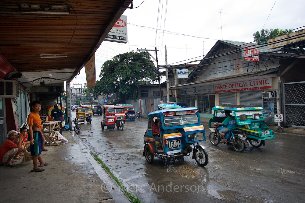 Tricycles on a busy street, Tagbilaran, Bohol, Philippines..