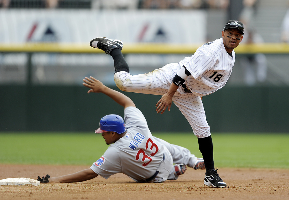 CHICAGO - JUNE 27:  Orlando Cabrera #18 of the Chicago White Sox turns a double play, avoiding a sliding Daryle Ward during the game against the Chicago Cubs at U.S. Cellular Field in Chicago, Illinois on June 27, 2008.  The White Sox defeated the Cubs 10-3.  (Photo by Ron Vesely)