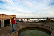 """On the top of the building an unfinished pool is full of dirty water. MACIEL uses to go up to dry his clothes. In mid-January he will flight to England in search of work. """"In Portugal there is no more hope for better days"""" he says."""