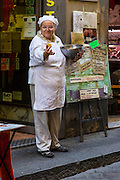 Lady, chef, outside La Padellaccia, restaurant, Firenze; Florence; Italy, offering free taste of food.