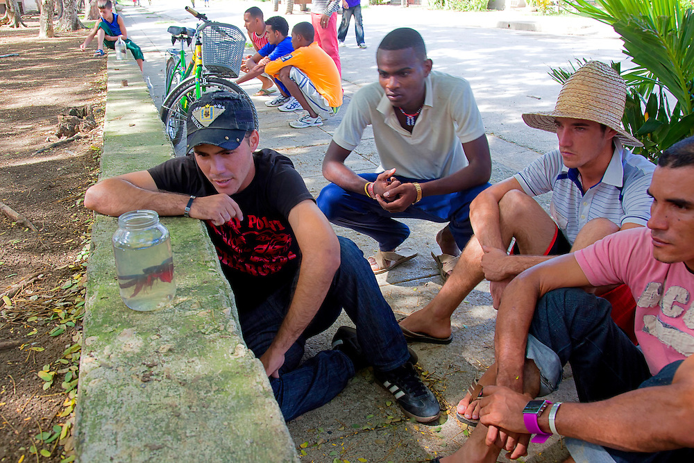 Men with fighting fish in Cueto, Holguin, Cuba.