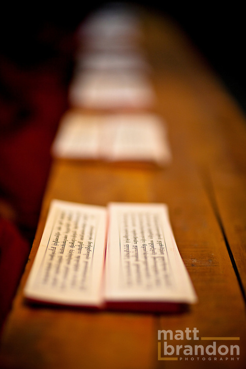Buddhist writings in Tibetan script lay on a bench table waiting for the monks to read.