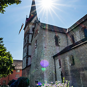 Sun starburst over steeple. The cathedral of Münster Allerheiligen (All Saints Church) was built in Romanesque style in 1103, the oldest building in Schaffhausen. Kloster Allerheiligen (All Saints Abbey) is a former Benedictine monastery in Schaffhausen, Switzerland, Europe.