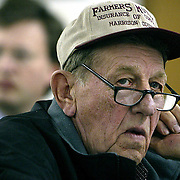 auction -- lineville, jan. 24 -- Bill Magee, from Bethany, Mo., listens to the auctioneer at a land auction in Lineville, Ia., on Monday (Jan. 24th).  Magee was interested in bidding on a piece of land near Lineville, but decided that the starting price was too high.  photo by david peterson