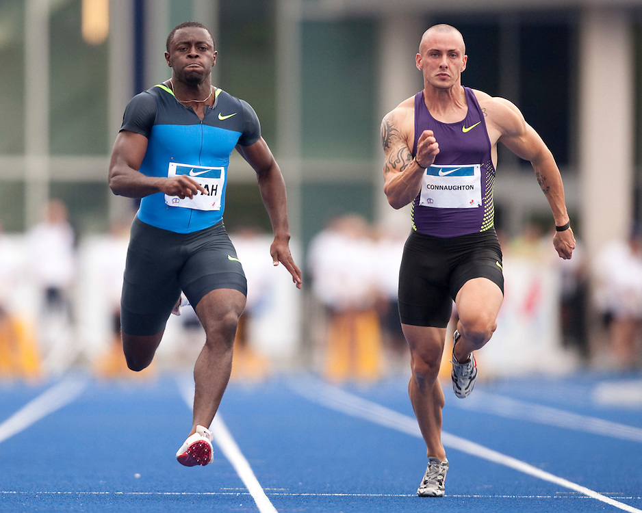 Toronto, Ontario ---10-07-31--- Sam Effah(L) and Jared Connaughton competes in the final of the mens 100 metres at the 2010 Canadian Track and Field Championships in Toronto, Ontario July 31, 2010.<br />  GEOFF ROBINS/Mundo Sport Images