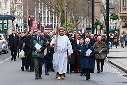 Hundreds of Christians in London take part in the interdenominational Methodist, Anglican and Catholic March of Witness in Westminster. PICTURED: The cross is carried towards Westminster Cathedral