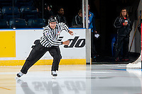 KELOWNA, CANADA - NOVEMBER 9: Linesman enters the ice on November 9, 2015 during game 1 of the Canada Russia Super Series at Prospera Place in Kelowna, British Columbia, Canada.  (Photo by Marissa Baecker/Western Hockey League)  *** Local Caption *** ice official