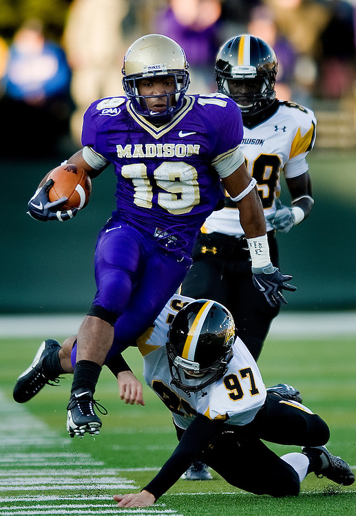 James Madison's Scotty McGee evades a tackle along the sideline during first quarter action against Towson at Bridgeforth Stadium in Harrisonburg on Saturday..