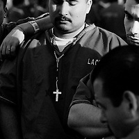 ..Convict Paul Zelaya listens with fellow inmates at Pitchess Honor Rancho to a Christian volunteer exorting the virtues of Christianity. Pitchess is part of the sprawling LA County Jail system that houses 21,000 inmates, the world's largest prison population.