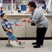 metro--  Eight year-old Joey Huerta meets nurse Susan Douglass who helped him when the yougster was nearly killed in a June auto accident on Interstate 35.  He was one of five kids in the car and suffered severe head injuries.  He came back to the hospital to give thanks to medical staff and to present plaques and gifts for those that helped save his life.  ( Joshua Trujillo / Staff )