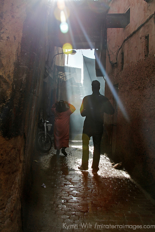 Africa, Morocco, Marrakech. Silhouetted people in souks of Marrakech.