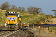 A Union Pacific train of empty intermodal cars works upgrade in the Tehachapi Mountains of southern California.