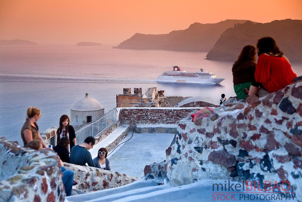 Viewpoint over the caldera. Oia village at sunset. <br /> Santorini island. Cyclades islands, Aegean Sea, Greece, Europe.