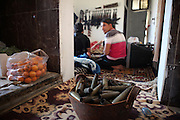 A bag of oranges and a basket of collected tank shells from syrian army assaults are seen in a kitchen of a local FSA rebell unit. Taftanaz northeast of Idlib city was seriouosly attacked in April by helicopters from a nearby air base. dozens of houses were bombed to the ground and many peolpe were killed as well.