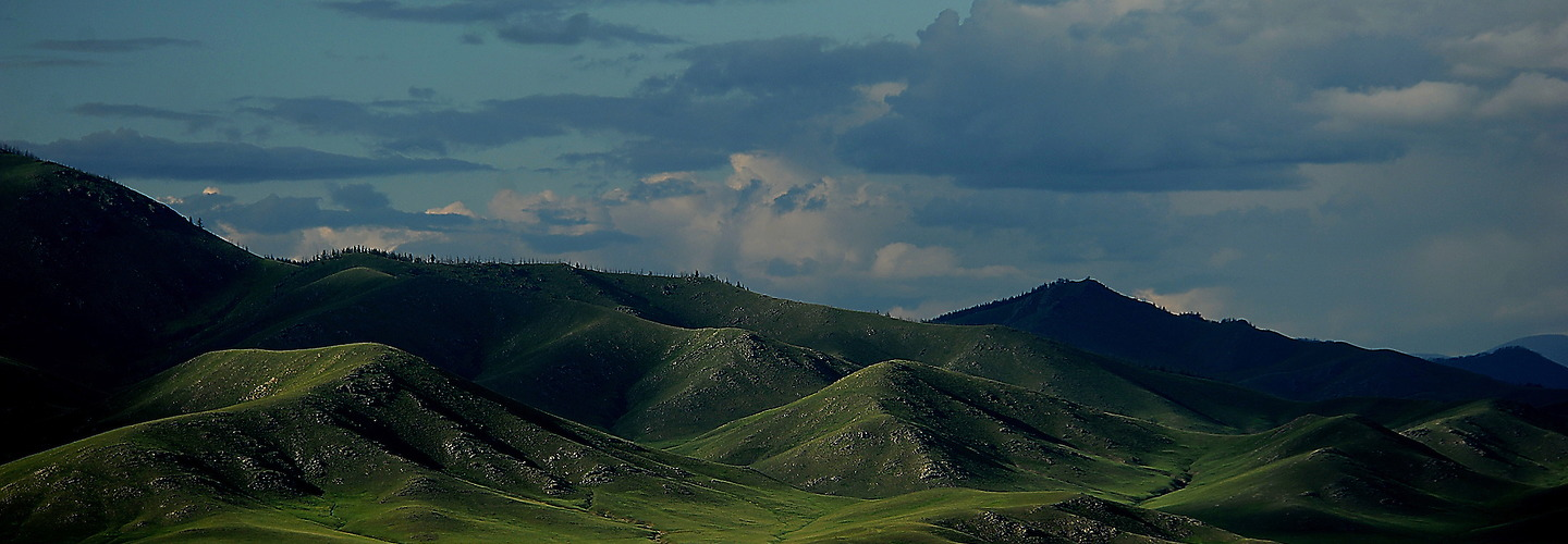 """Mongolia is known as the country of """"Blue Sky.""""  It can be divided into four natural zones: mountain-forest steppe, mountain steppe and, in the extreme south, semi-desert and desert. It is 1,564,116 square kilometers and is slightly smaller than Alaska. Mongolian herders live throughout the land with their families in tents called Gers.  Deforestation, overgrazing, and agricultural production have lead to soil erosion and desertification. 