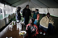 """OHIO, Toledo, October 28, 2012: Sunday morning breakfast inside the tent city arranged in Toledo by the church organization """"1Matters.org"""" to distribute clothes and food to homeless and people living below the poverty line. ALESSIO ROMENZI"""