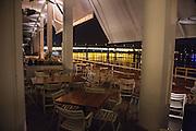 Outdoor seating area of Comunale restaurant in Beton Hala.<br /> <br /> Savamala neighborhood of Belgrade, Serbia.