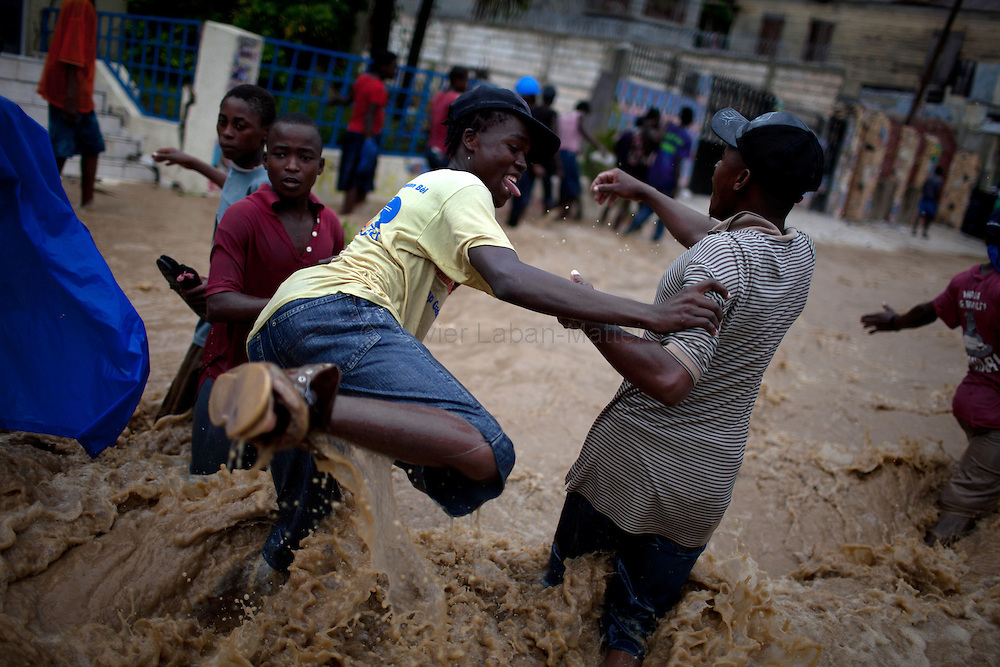 After hurricane Tomas went through Haiti, the city of Leogane has been totally flooded by the heavy rain and the overflow of the river Roullorne.///A Haitian woman tries to go out of the the muddy water, in a street of Leogane during hurricane Tomas.
