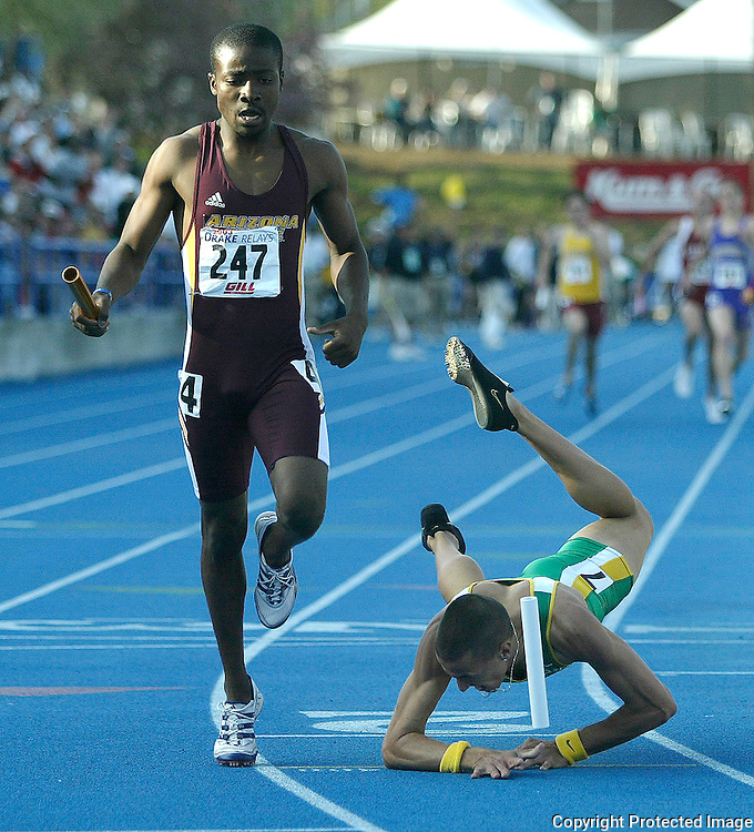 DRAKE -- des moines, april 26 -- Arizona State's Lewis Banda, nips a diving Jeremy Wariner from Baylor by 1/100th of a second in the Drake Relays final event of the day, the 4 X 400 University Men's relay.  photo by david peterson  s