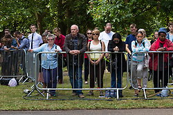 Hyde Park, London, July 7th 2015. Members of the public reflect ast they participate in  a minute's silence at 11.30 am at the memorial for the victims of 7/7 in Hyde Park