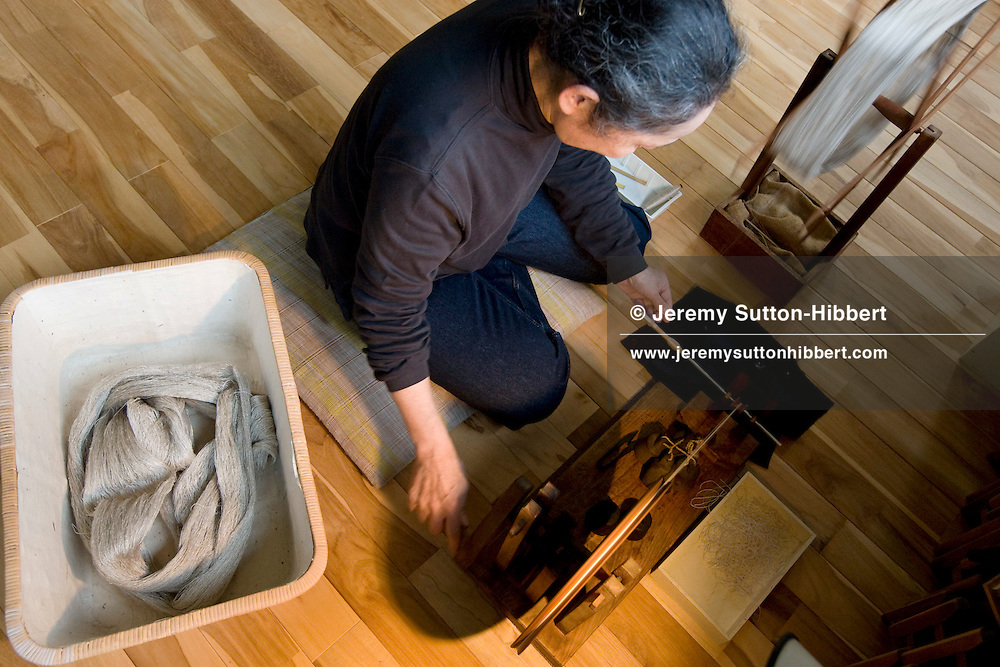 Artisan weaver Ikuko Ida, in her home studio where she hand weaves her silk kimono materials, in Kiryu, Japan, on Monday, March 23rd, 2008.  Ida-san has 4 times won awards from the Mingei-Kan folk crafts cultural body.