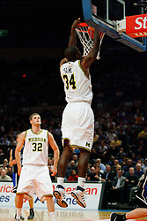 Nov 21, 2008; New York, NY, USA; Michigan Wolverines forward DeShawn Sims (34) dunks the ball during the 2K Sports Classic Championship game against the Michigan Wolverines at Madison Square Garden. Duke won 71-56.